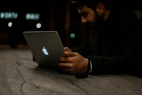 Photo of Man Using Macbook