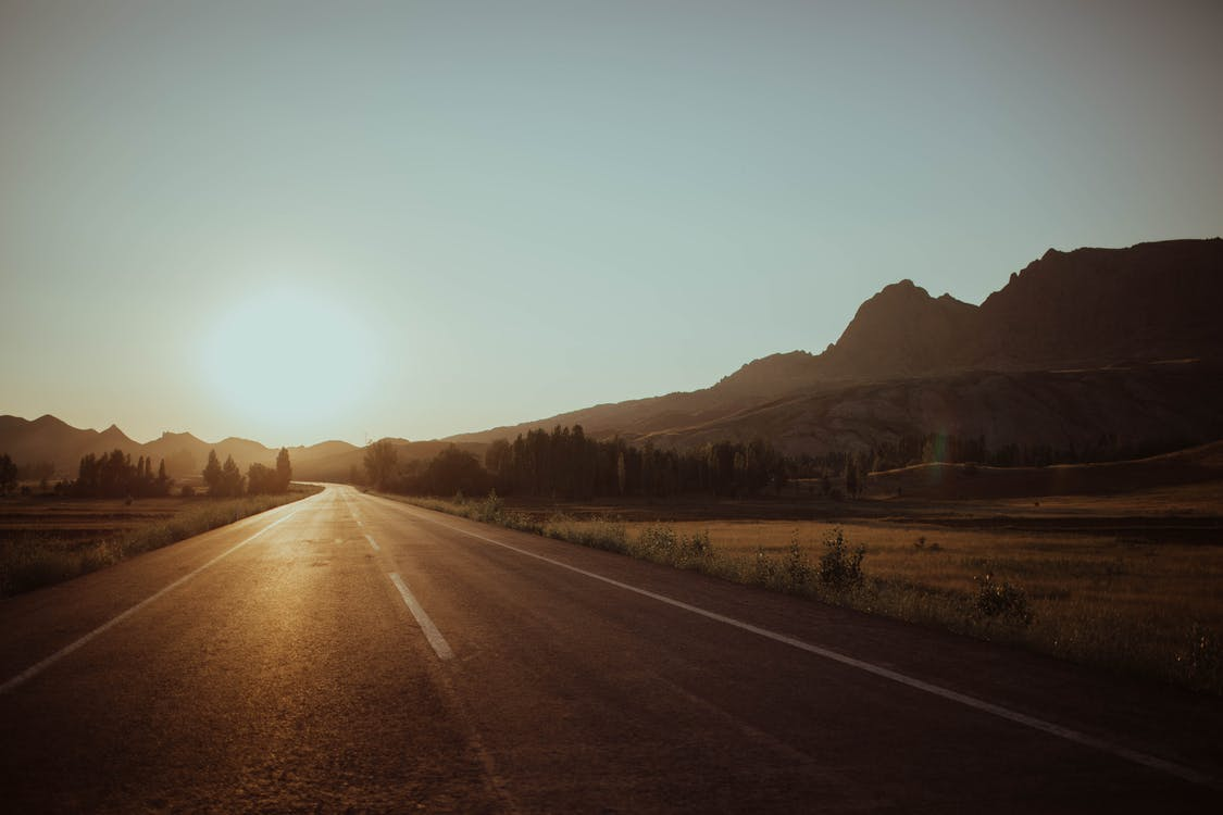 Empty Road With View Of Sunset