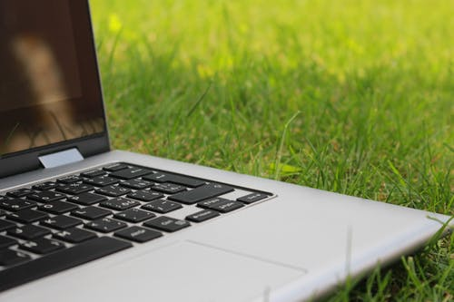 Shallow Focus Photography of Gray Laptop