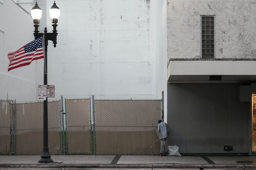 Free stock photo of american-flag, empty street, homeless, street light