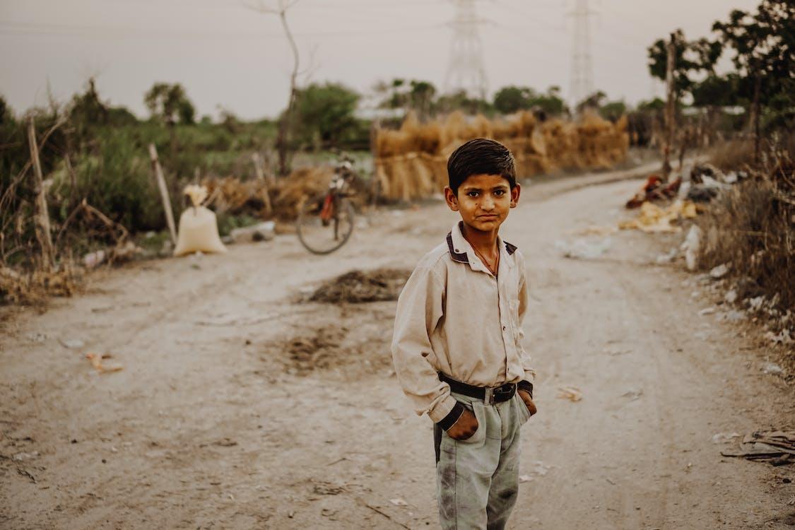 Boy Standing in Road
