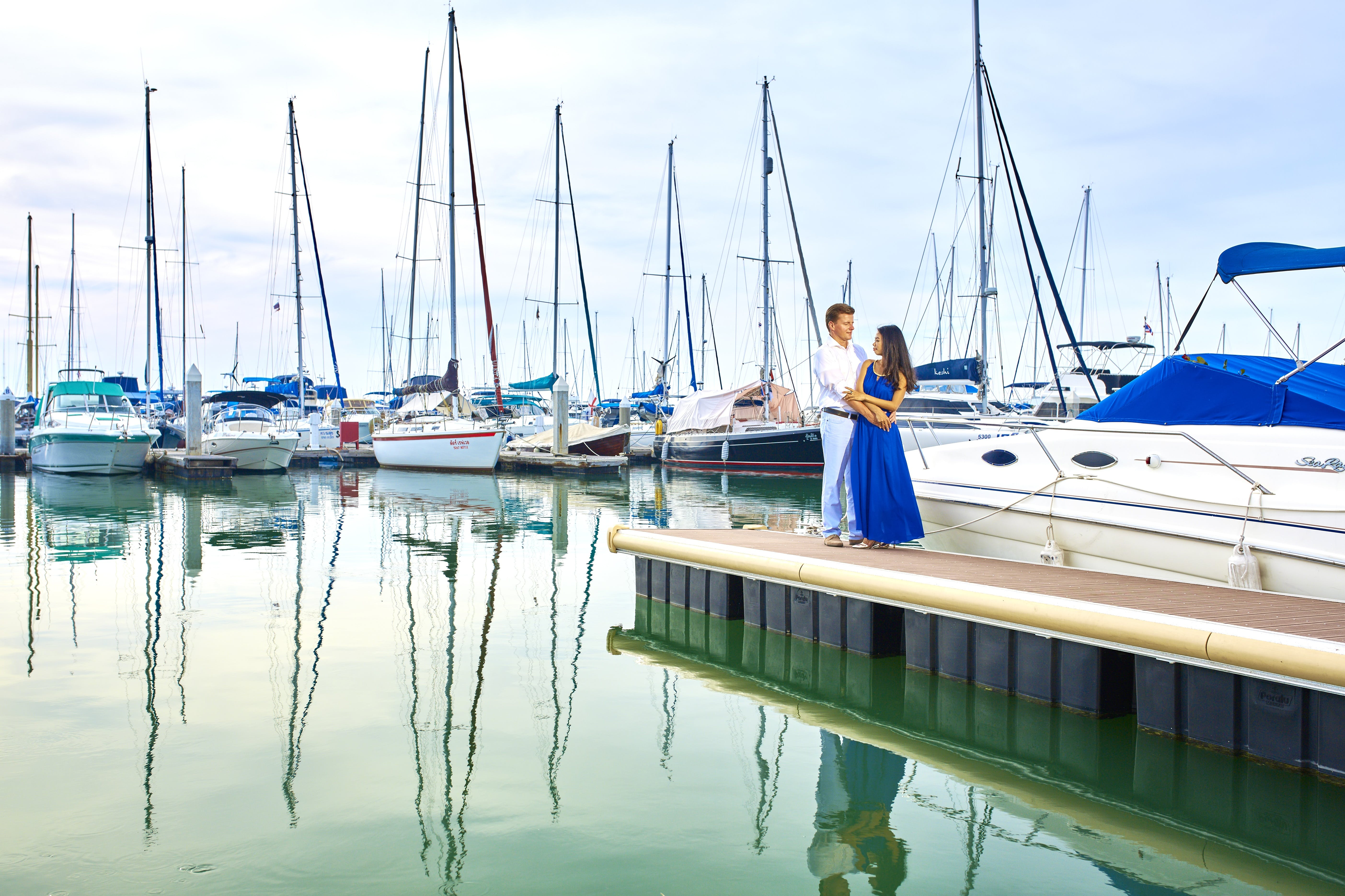 Man and Woman Standing Near Boat
