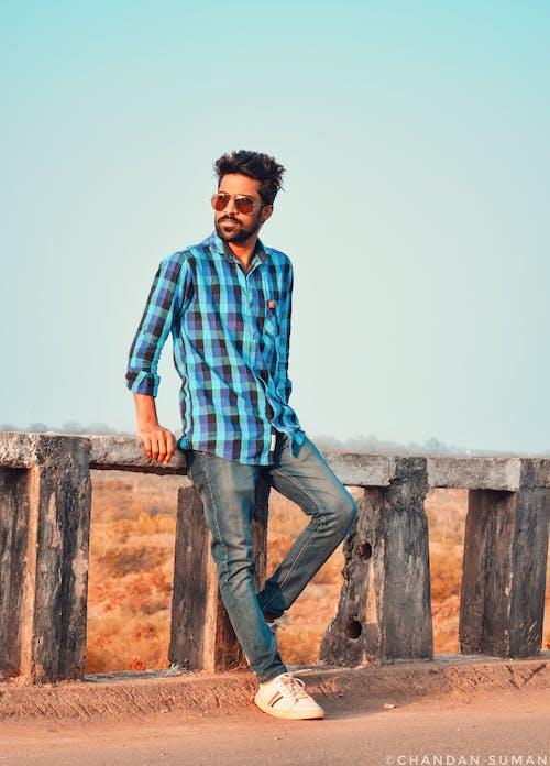 Free stock photo of bearded man, blue sky, outdoor photography, photoshoot