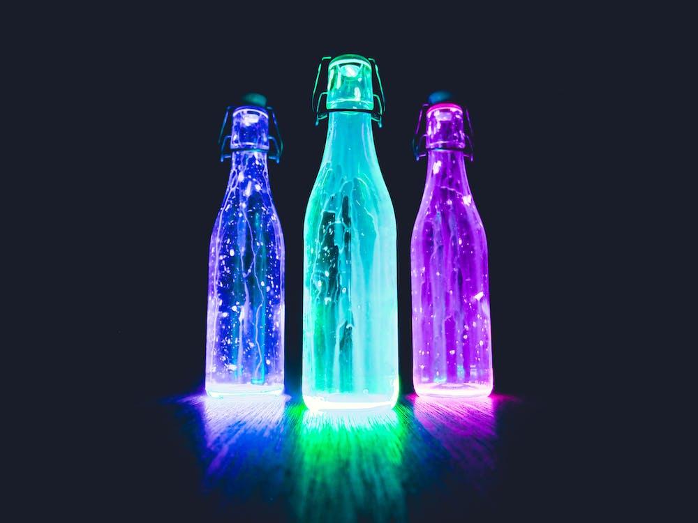 Three Lighted Bottles
