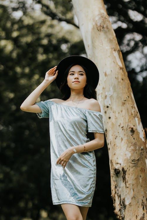 Women's Blue Off-shoulder Blouse Close-up Photography