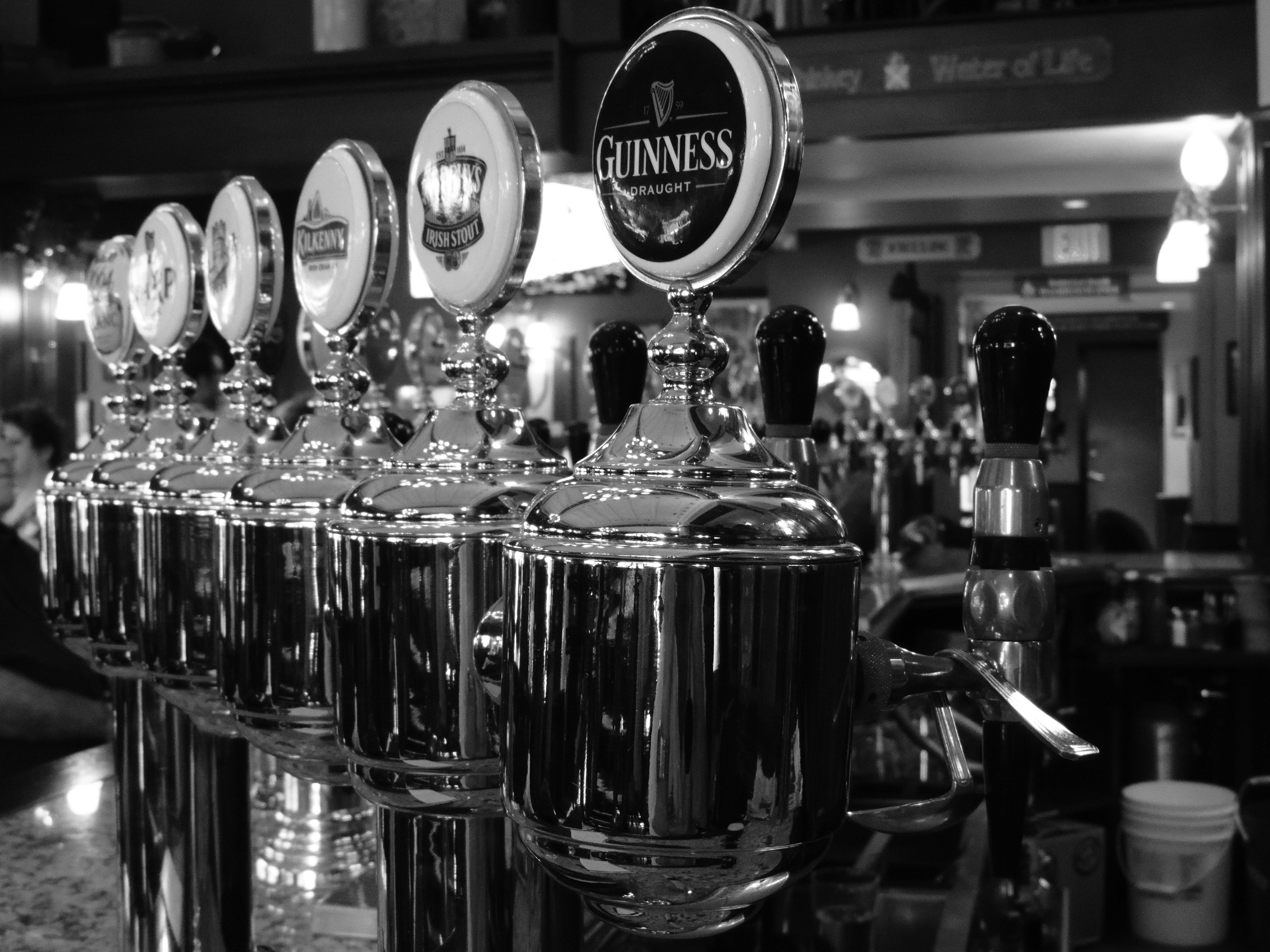 Grayscale Photography of Beer Dispenser