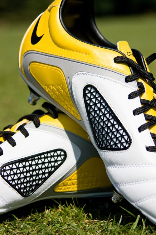 Pair of White-yellow-and-gray Soccer Cleats