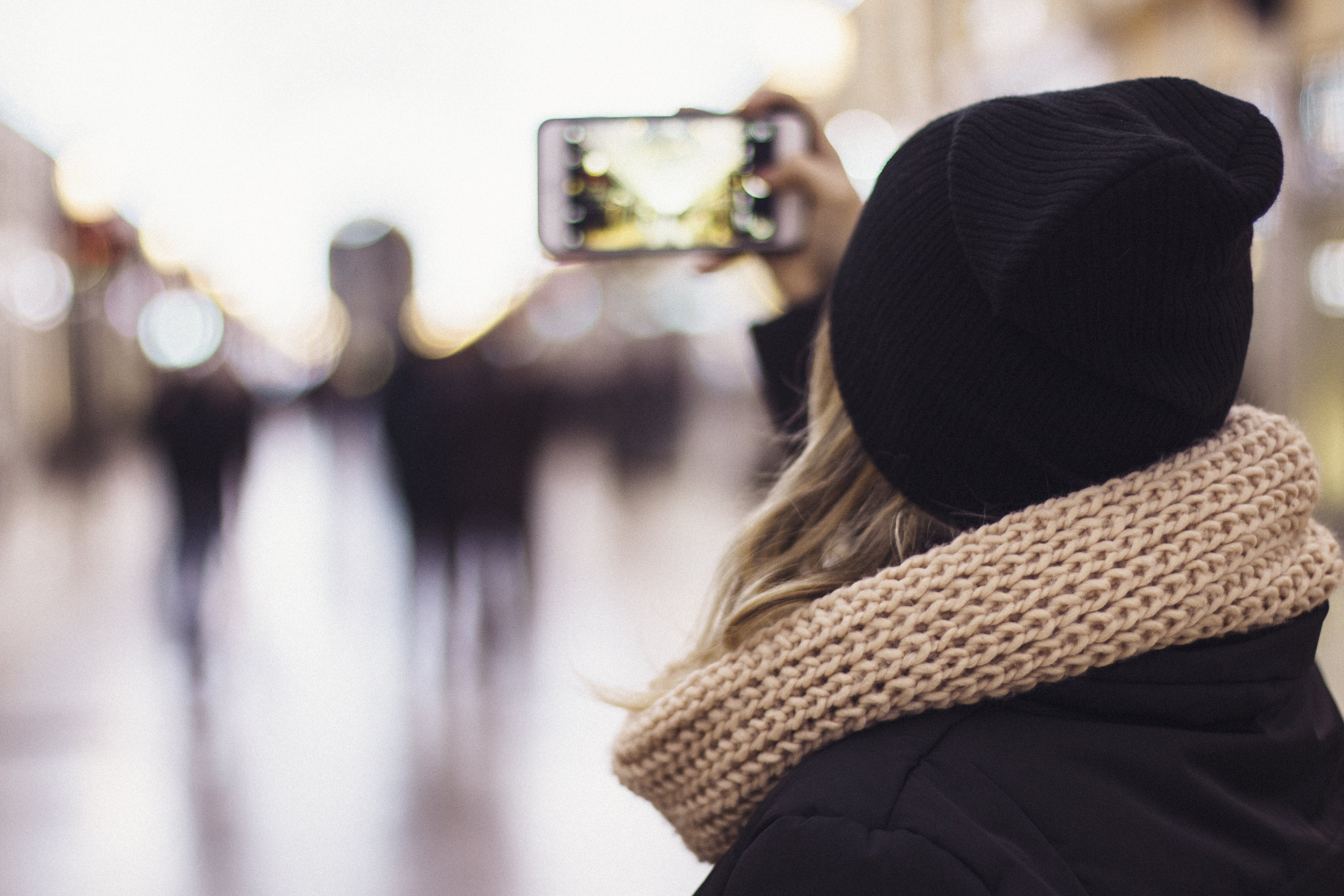 Woman Wearing Brown Scarf Taking Picture