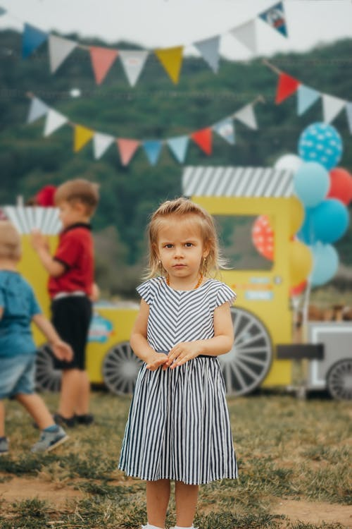 Photo of Girl Wearing Striped Dress
