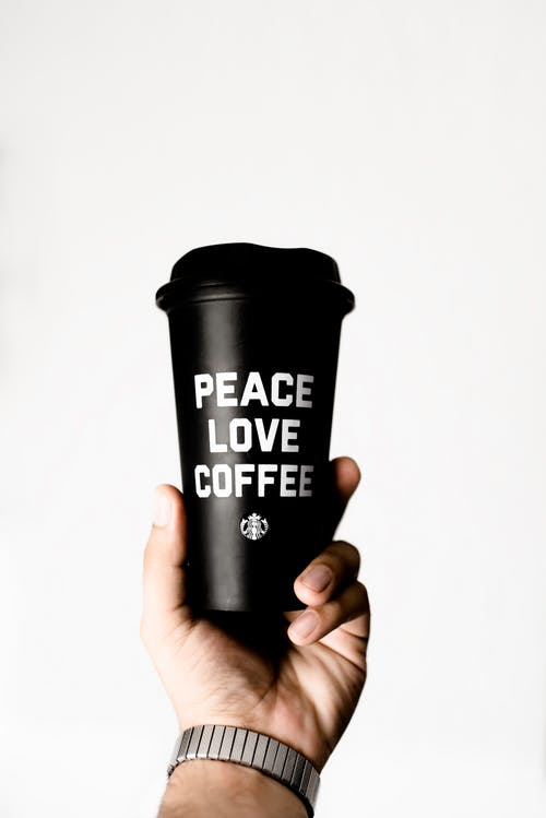 Person Holding Starbucks Coffee Tumbler