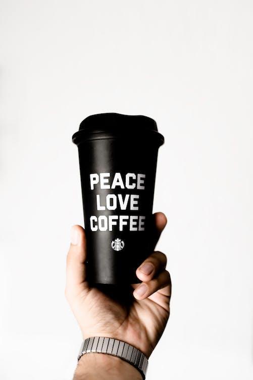 Person Holding Starbucks Coffee Tumbler
