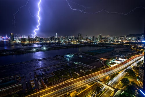 Time-Lapse Photography of Lightning Above Lighted Buildings During Night