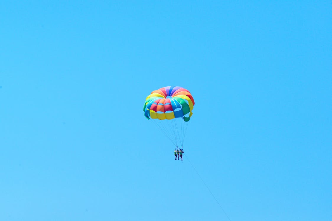 People Flying in a Parachute