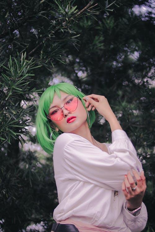Woman With Green Hair Wearing Hoop Earrings
