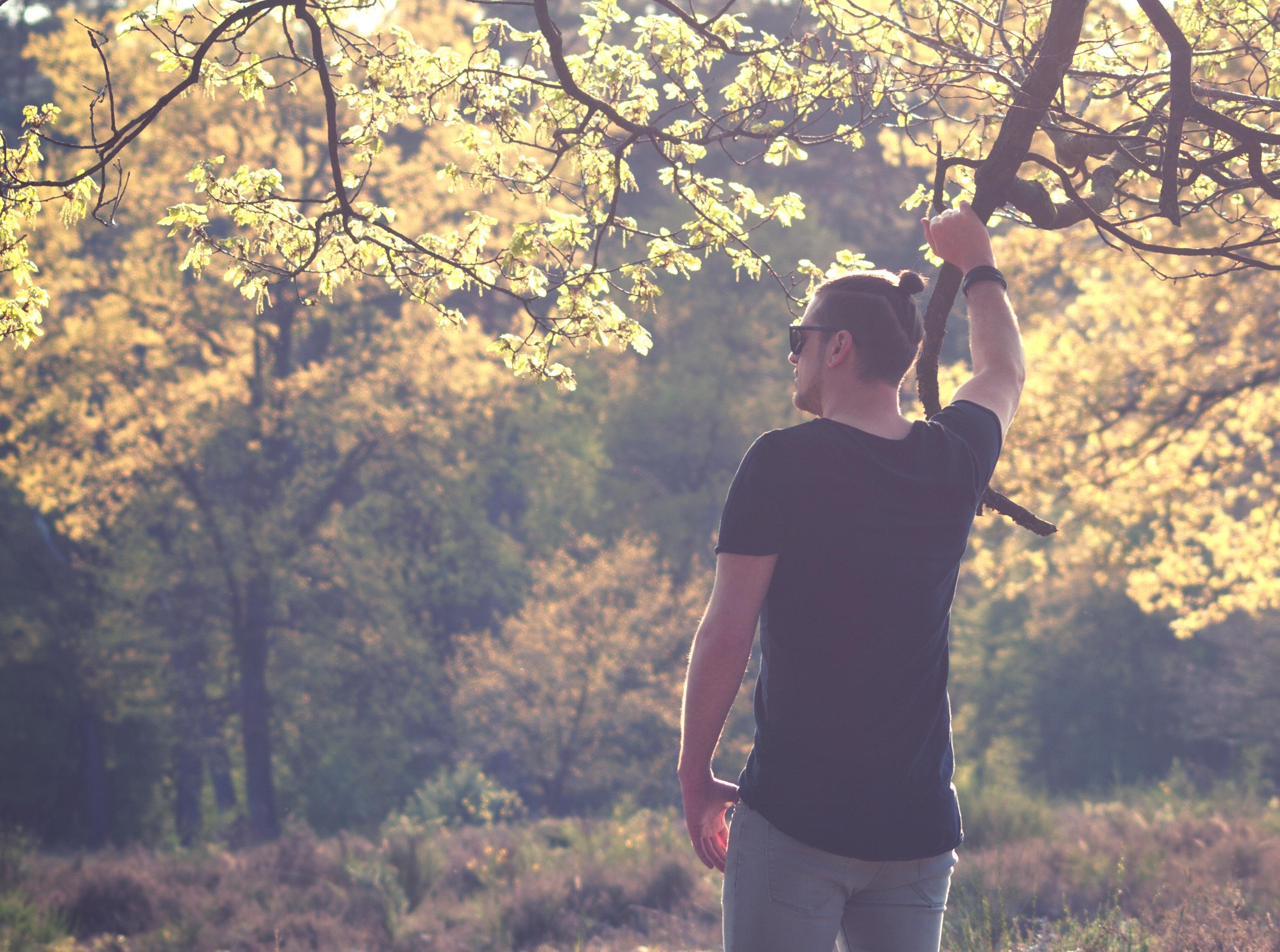 Man Holding Tree Twig