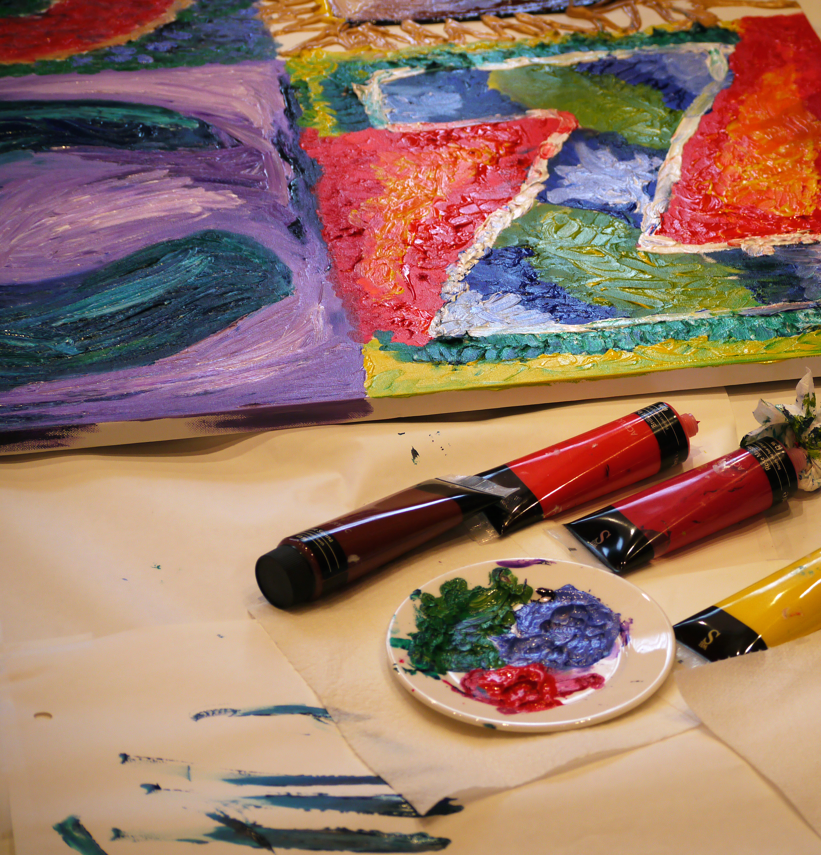 Acrylic Paint Tubes Near Painting