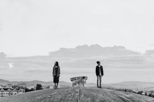 Man and Woman Standing Outdoor
