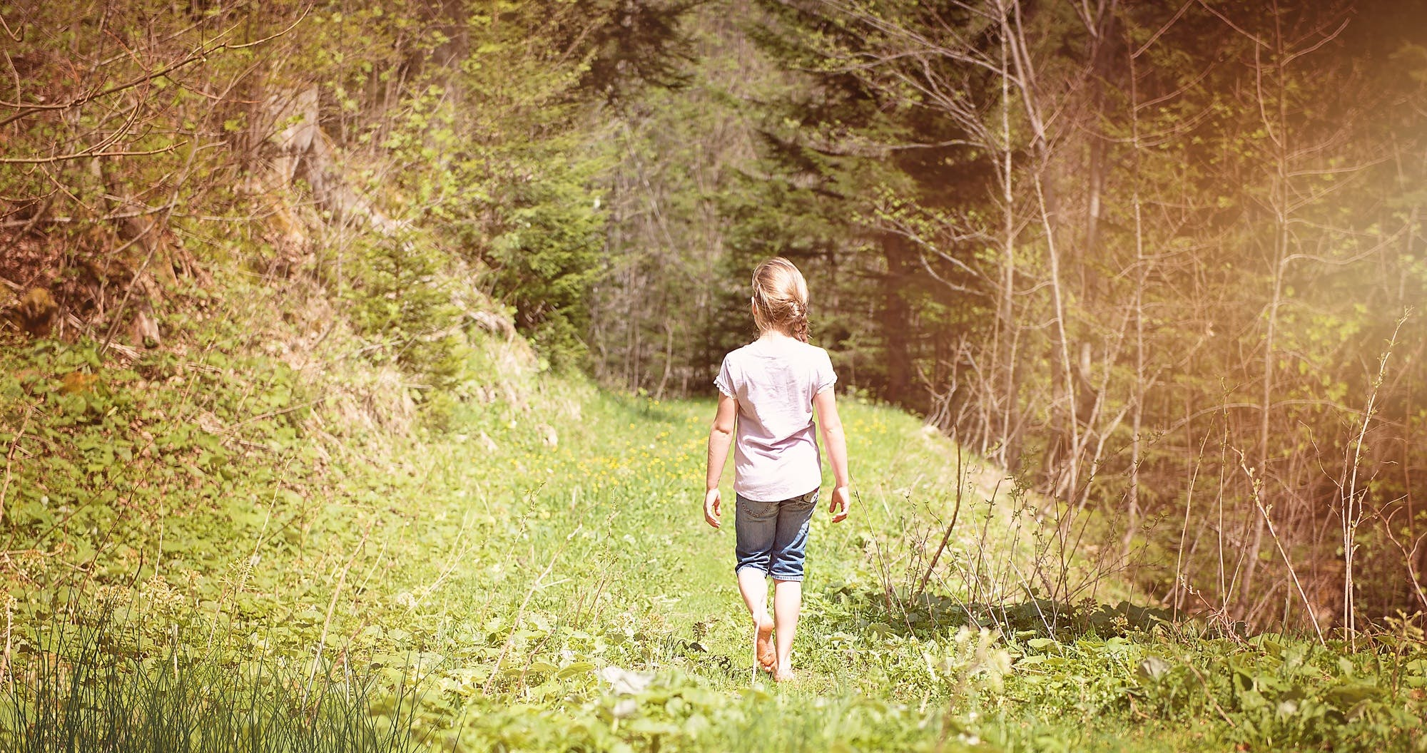 Girl Waling Across the Forest