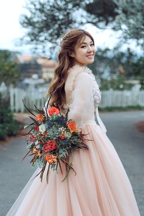 Woman Wearing Beige Wedding Dress
