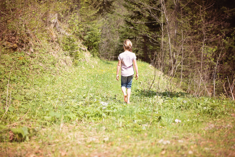 Girl Walking Across the Forest