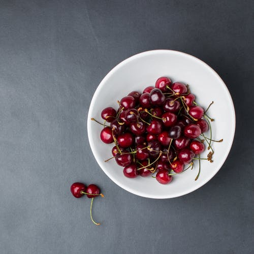 Cherries on White Ceramic Bowl