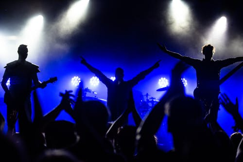 Free stock photo of arms raised, audience, band