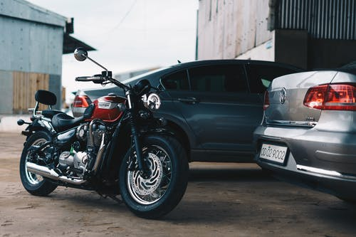 Photo of Motorcycle Parked Near Cars
