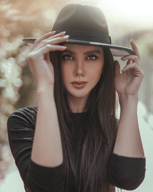 Woman Wearing Black Hat