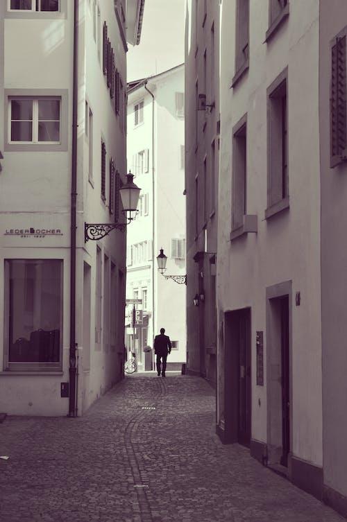Man Walking on Street Alley