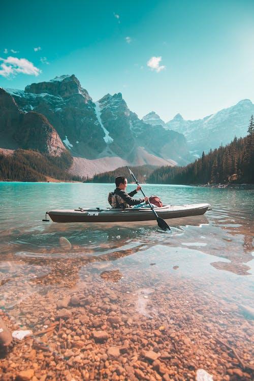 Person Riding on Gray Kayak