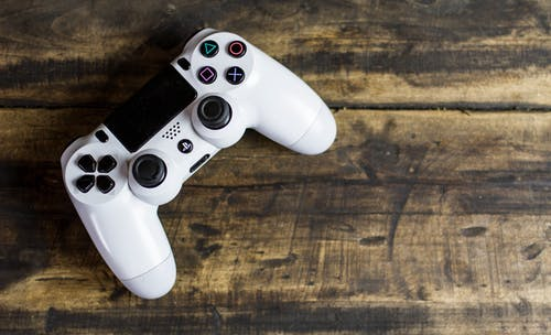 White Sony Ps4 Dualshock Placed on Table