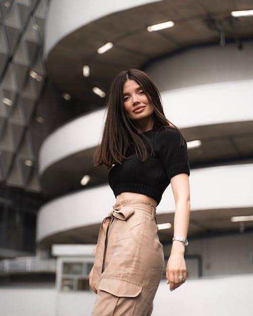 Woman Wearing Black Shirt and Brown Pants