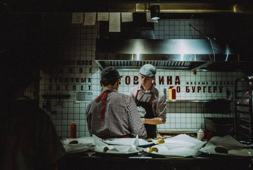 People Inside Commercial Kitchen