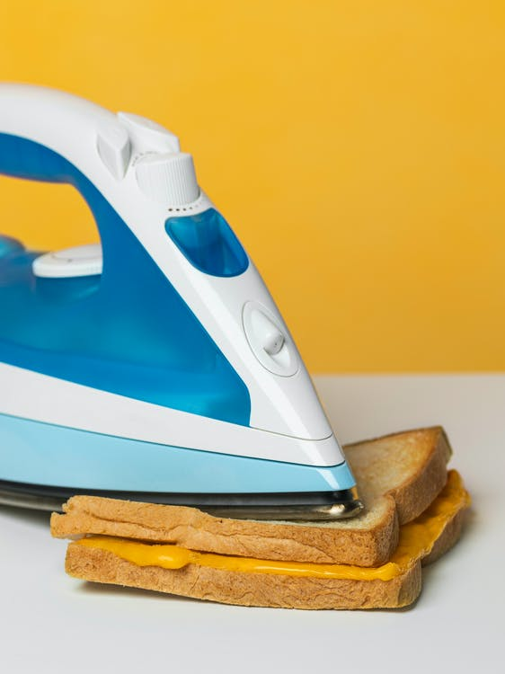 White And Blue Steam Iron