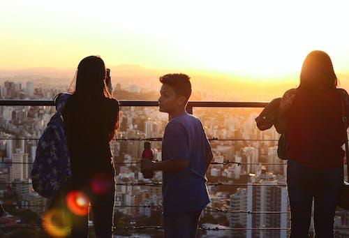 Foto stok gratis bh, cidade, jovens, matahari terbenam