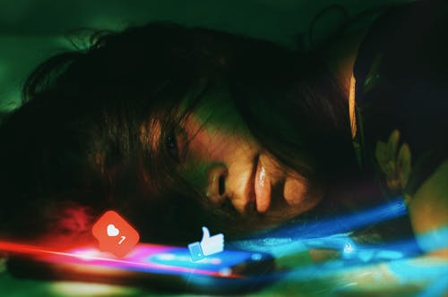 Photo Of Woman Lying Beside A Phone
