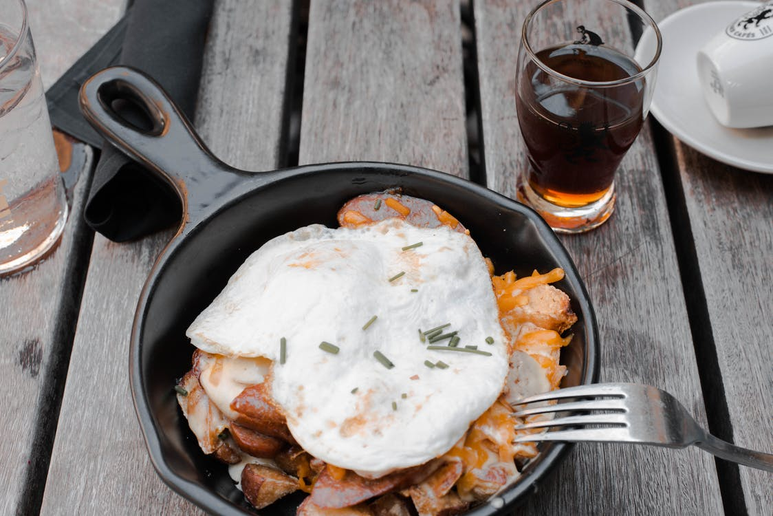 Cooked Eggs and Meat on Cast-iron Pan
