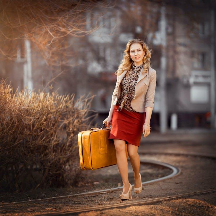 Woman in Brown Blazer Holding Brown Briefcase
