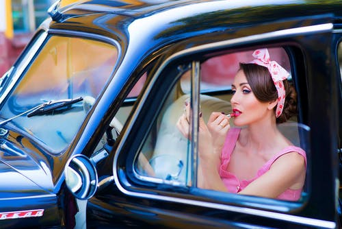 Woman In Pink Sleeveless Dress In A Vehicle
