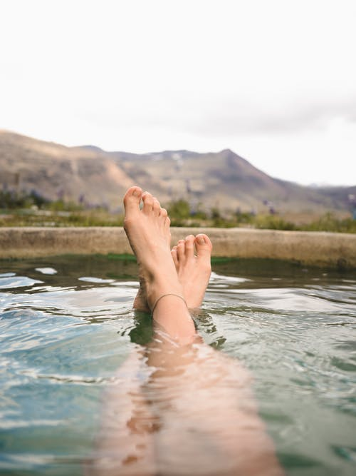 Photo of Person's Feet During Daytime