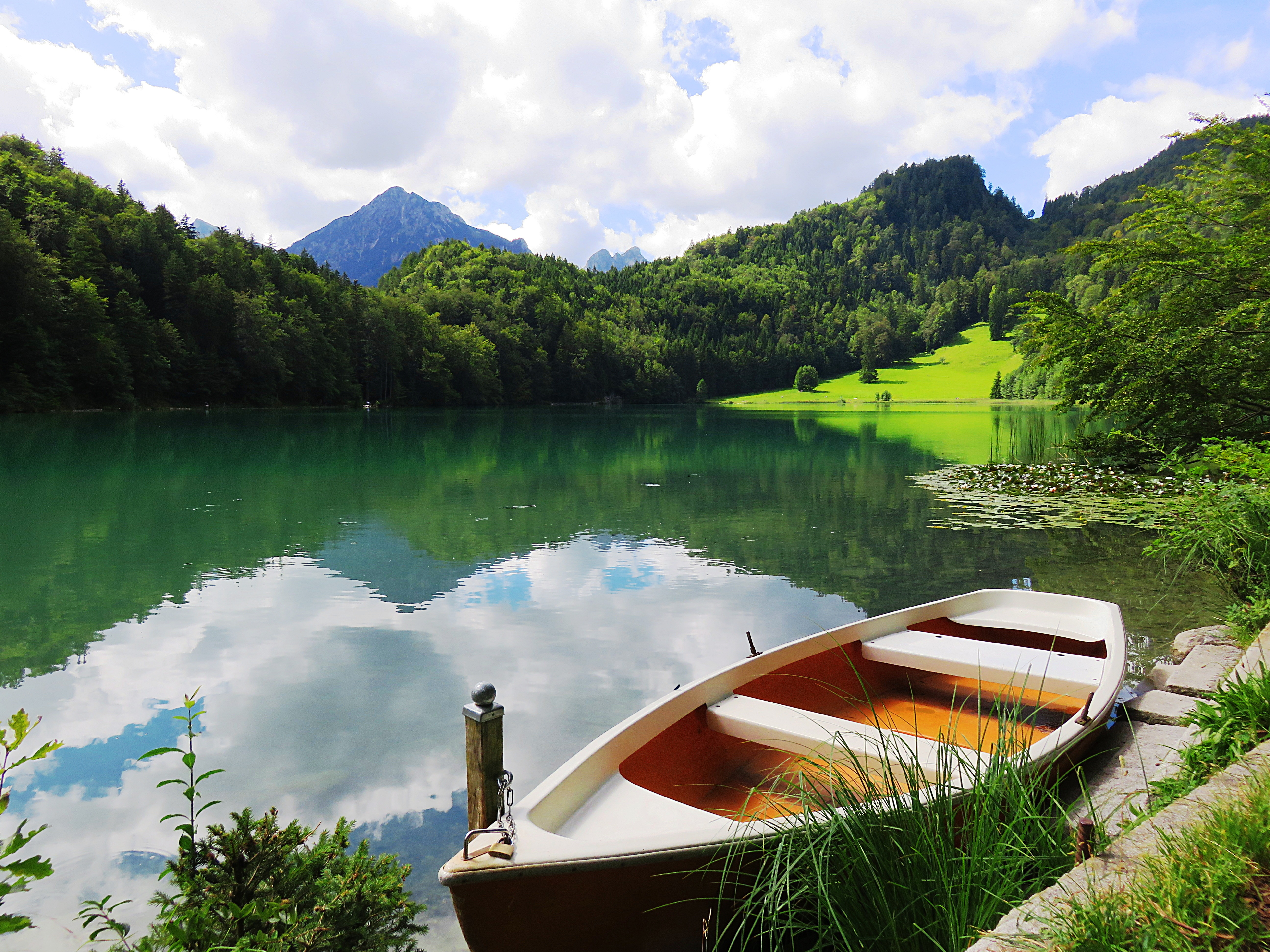 Boat on Dock With Mountain Background
