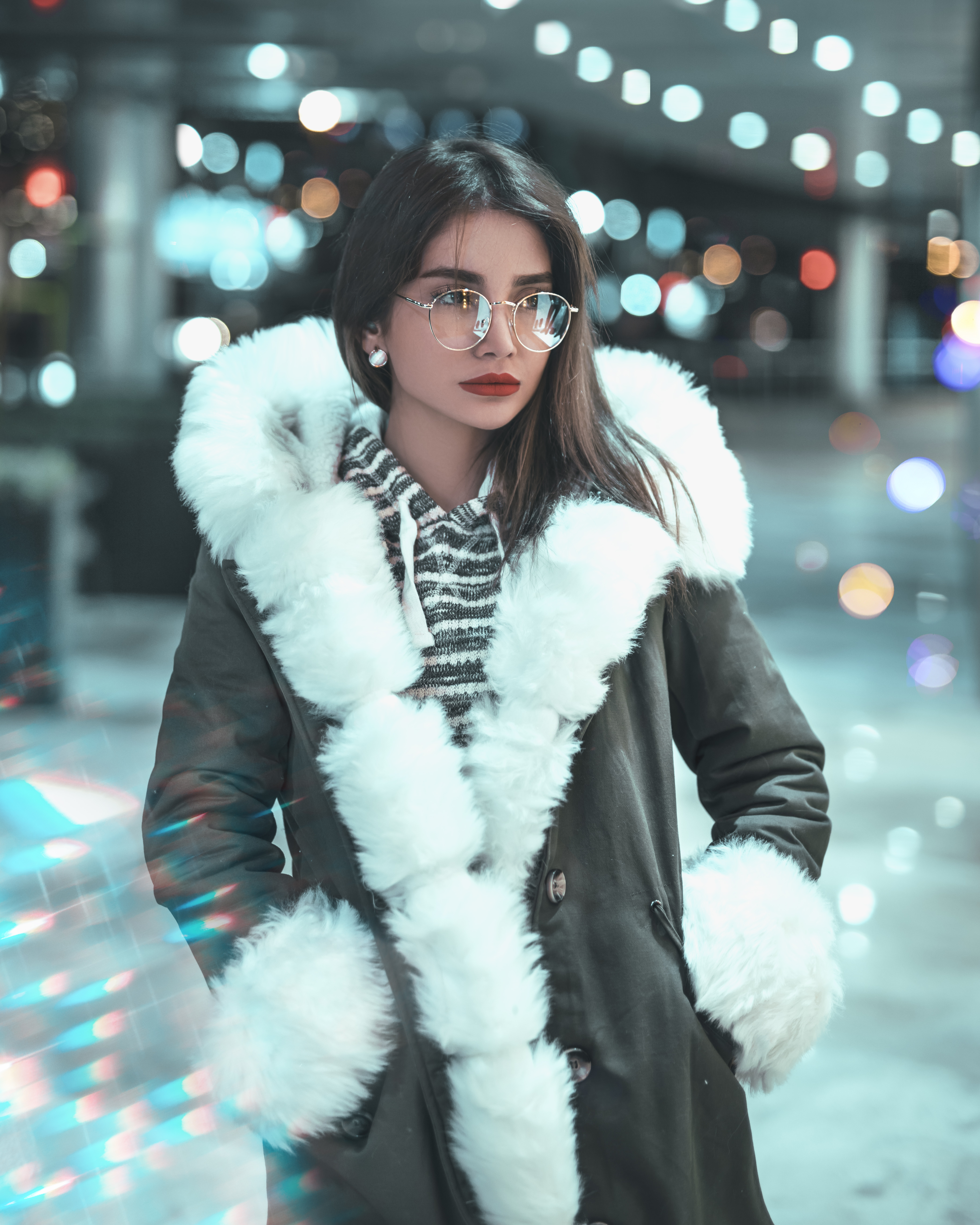 Photo of Woman Wearing Fur Coat