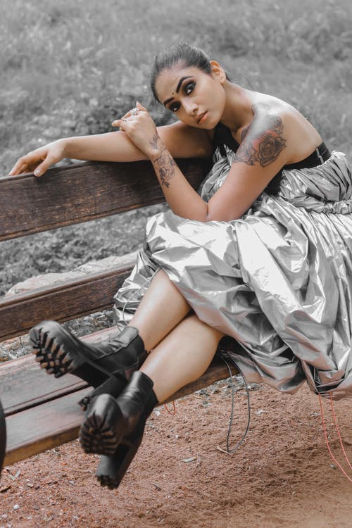 Woman in Gray Silk Tube Dress and Black Boots