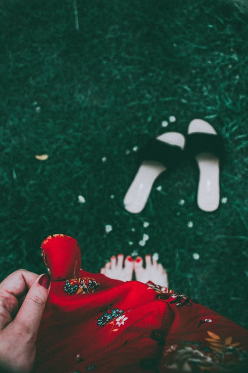 Woman Wearing Red Printed Dress Standing on Green Grass Barefooted