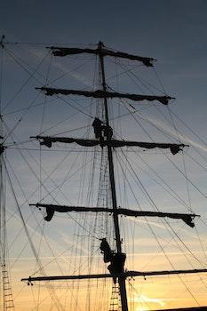 Free stock photo of sunset, boat, sail, mast