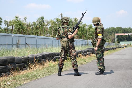 Two Soldiers Standing On Road