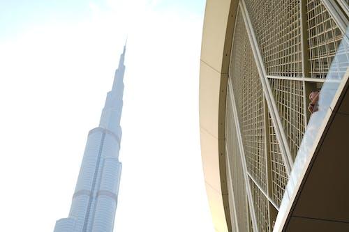 Безкоштовне стокове фото на тему «Бурдж Халіфа, Дубай, дубай центр, людина на вікні»