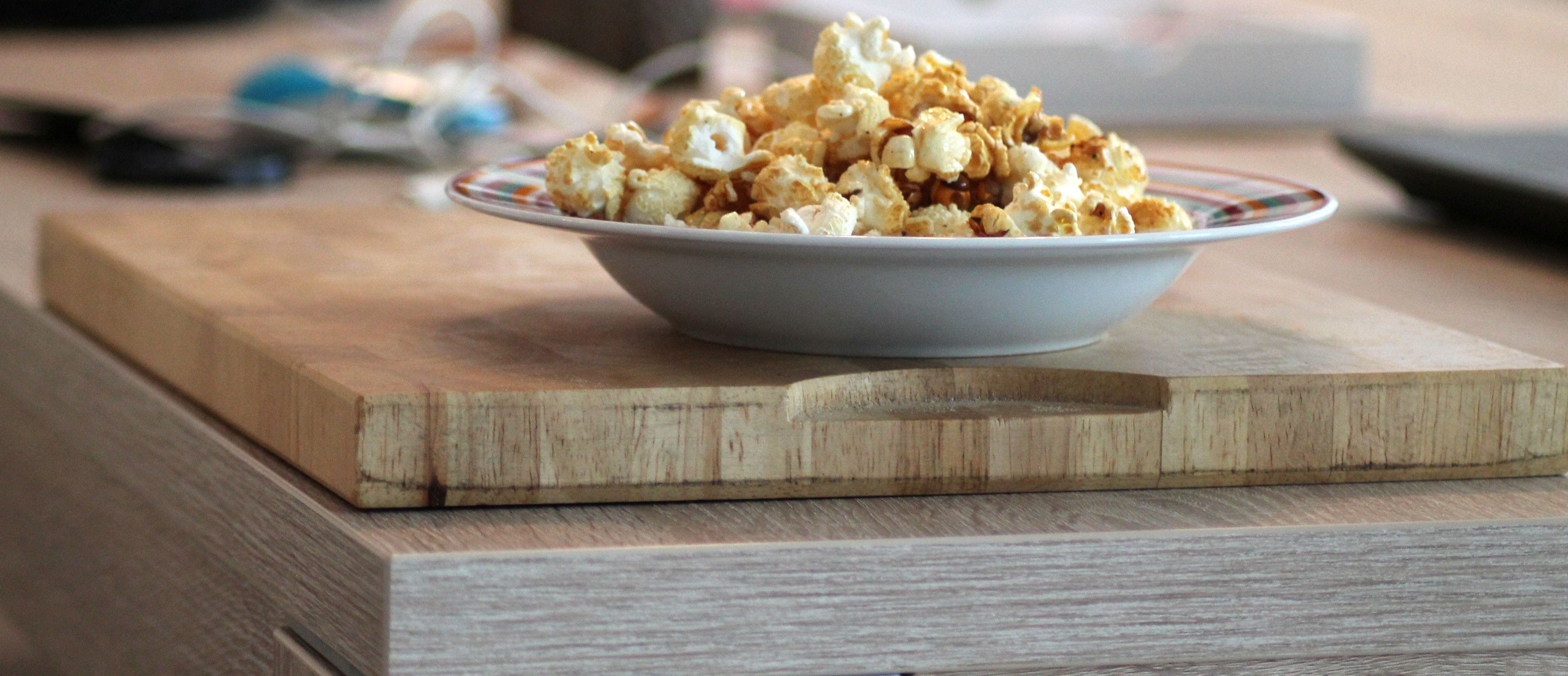 Popcorn in Bowl Placed on Chopping Board