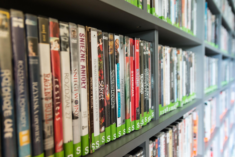 Assorted Dvd Case Lot on Shelves