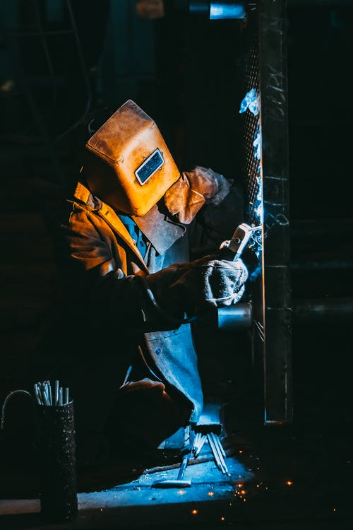 Person Welding Metal